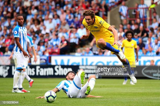 Christopher Schindler of Huddersfield Town fouls Marcos Alonso of Chelsea and a penalty is awarded during the Premier League match between...