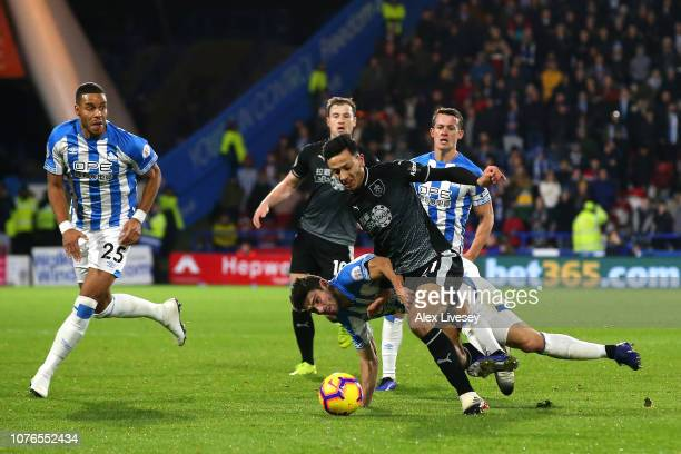 Christopher Schindler of Huddersfield Town is sent of following this tackle on Dwight McNeil of Burnley during the Premier League match between...