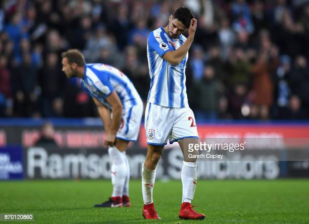 Christopher Schindler of Huddersfield Town looks dejected as he is sent off after being showed a red card during the Premier League match between...