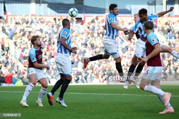 Christopher Schindler of Huddersfield Town scores his team's first goal during the Premier League match between Burnley FC and Huddersfield Town at...