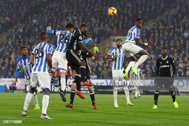 Christopher Schindler of Huddersfield Town scores his team's first goal during the Premier League match between Huddersfield Town and Fulham FC at...