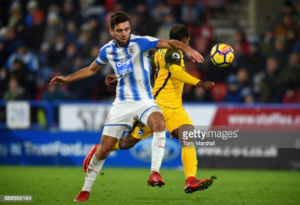 Christopher Schindler of Huddersfield Towntackles Jose Izquierdo of Brighton and Hove Albion during the Premier League match between Huddersfield...