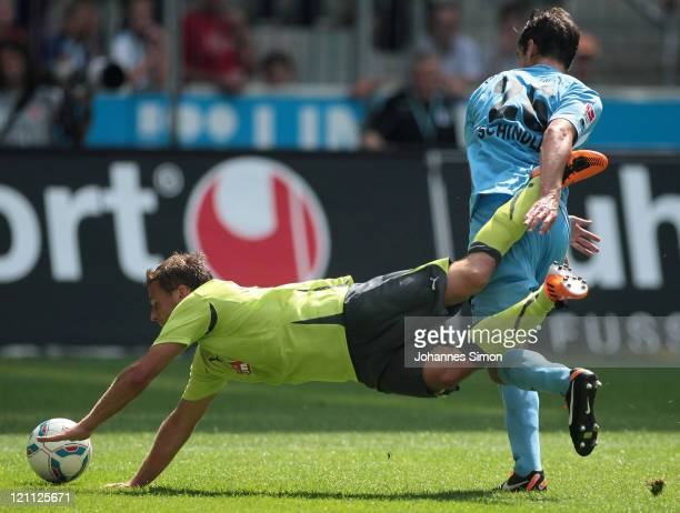 Christopher Schindler of Muenchen and Guido Kocer of Aue fight for the ball during the Second Bundesliga match between TSV 1860 Muenchen and...
