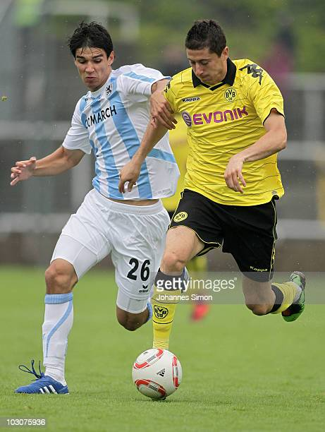 Christopher Schindler of Muenchen and Robert Lewandowski of Dortmund fight for the ball during the preseason friendly match 1860 Muenchen v Borussia...
