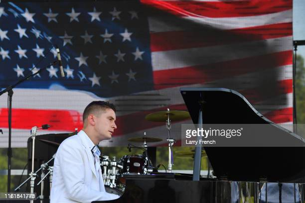 Christopher Schmitt White House Jazz Pianist performs at Grandiosity Events CigarsGuitars Charity PoloJazz charity event Powered by Logical...