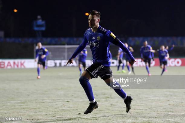 Christopher Schorch of 1 FC. Saarbruecken celebrates after scoring the winning penalty in the penalty shootout which lead to victory for 1. FC...