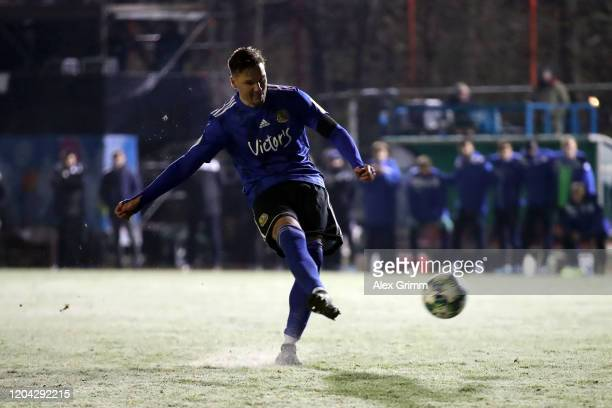 Christopher Schorch of 1 FC. Saarbruecken scores the winning penalty in the penalty shootout which lead to victory for 1. FC Saarbruecken in the DFB...
