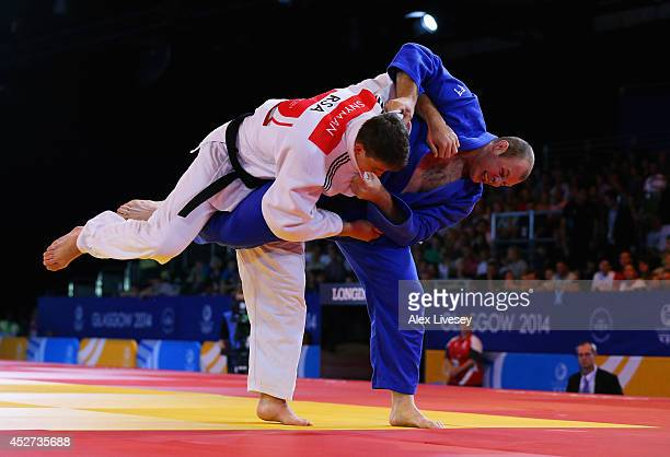 Christopher Sherrington of Scotland competes in the Men's 100kg Judo gold medal final against Ruan Snyman of South Africa at the Scottish Exhibition...