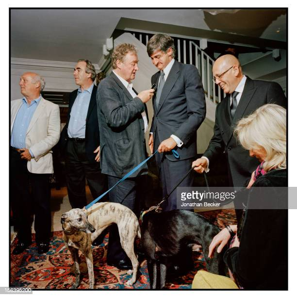 Christopher Simon Sykes, Robin Birley with his dog Roussie, and Claude Auchume with Birley's other dog, Ralph are photographed at 5 Hertford Street,...
