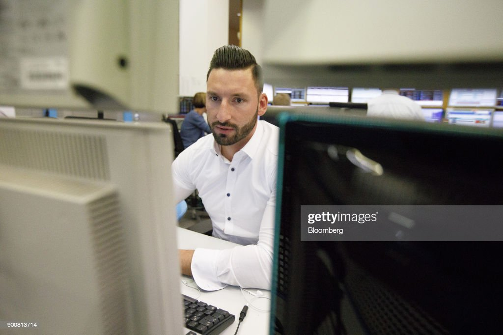 Christopher Sornberger, a specialist in floor equities at Oddo Seydler Bank AG, monitors financial data as the second iteration of the Markets in Financial Instruments Directive (MiFID II) comes into force, at the Frankfurt Stock Exchange, operated by Deutsche Boerse AG, in Frankfurt, Germany, on Wednesday, Jan. 3, 2018. After seven years of preparation, $2 billion in compliance costs and one false start, the biggest shake-up to European regulation in a decade is finally here. Photographer: Alex Kraus/Bloomberg via Getty Images