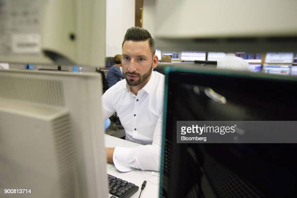 Christopher Sornberger a specialist in floor equities at Oddo Seydler Bank AG monitors financial data as the second iteration of the Markets in...