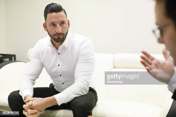 Christopher Sornberger a specialist in floor equities at Oddo Seydler Bank AG pauses during an interview as the second iteration of the Markets in...