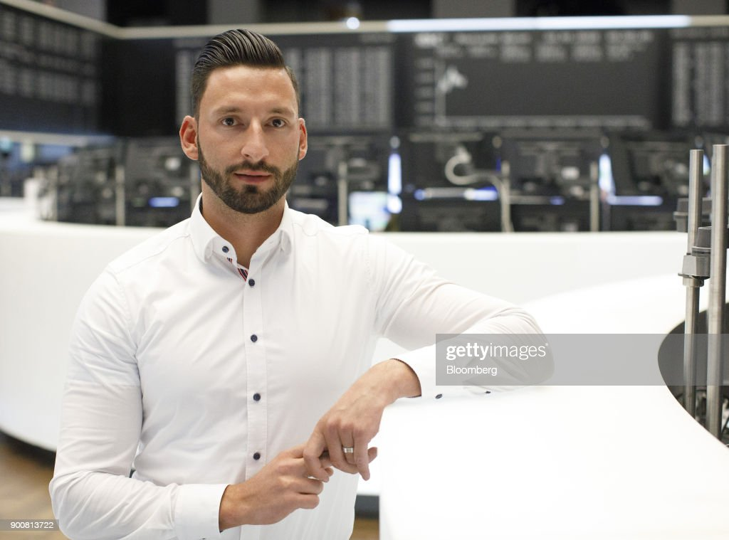 Christopher Sornberger, a specialist in floor equities at Oddo Seydler Bank AG, poses for a photograph on the trading floor as the second iteration of the Markets in Financial Instruments Directive (MiFID II) comes into force, at the Frankfurt Stock Exchange, operated by Deutsche Boerse AG, in Frankfurt, Germany, on Wednesday, Jan. 3, 2018. After seven years of preparation, $2 billion in compliance costs and one false start, the biggest shake-up to European regulation in a decade is finally here. Photographer: Alex Kraus/Bloomberg via Getty Images