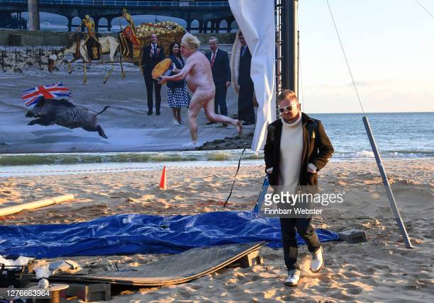 Christopher Spencer, aka: Cold War Steve poses in front of the censored artwork on Boscombe beach on September 25, 2020 in Bournemouth, England. The...