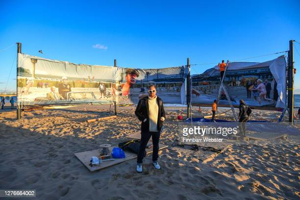 Christopher Spencer aka Cold War Steve poses in front of the censored artwork on Boscombe beach on September 25 2020 in Bournemouth England The...