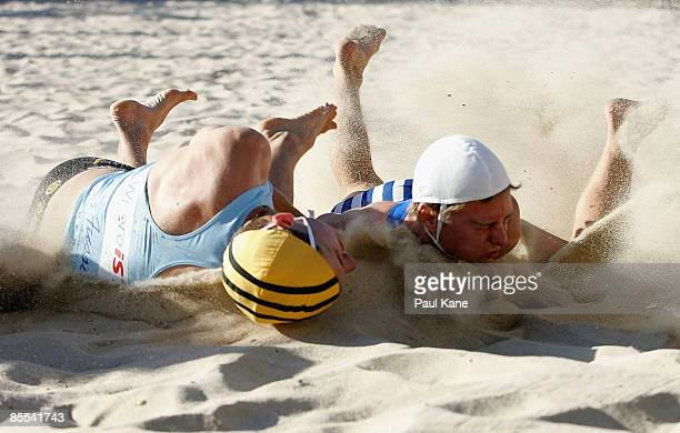 Christopher Stewart of Alexandra Headland competes for the flag against Thomas Nolan of North Cottesloe in the Open Men's Flag Race final during day...