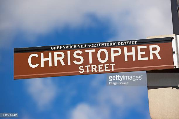 christopher street sign - usa parade stock photos and pictures