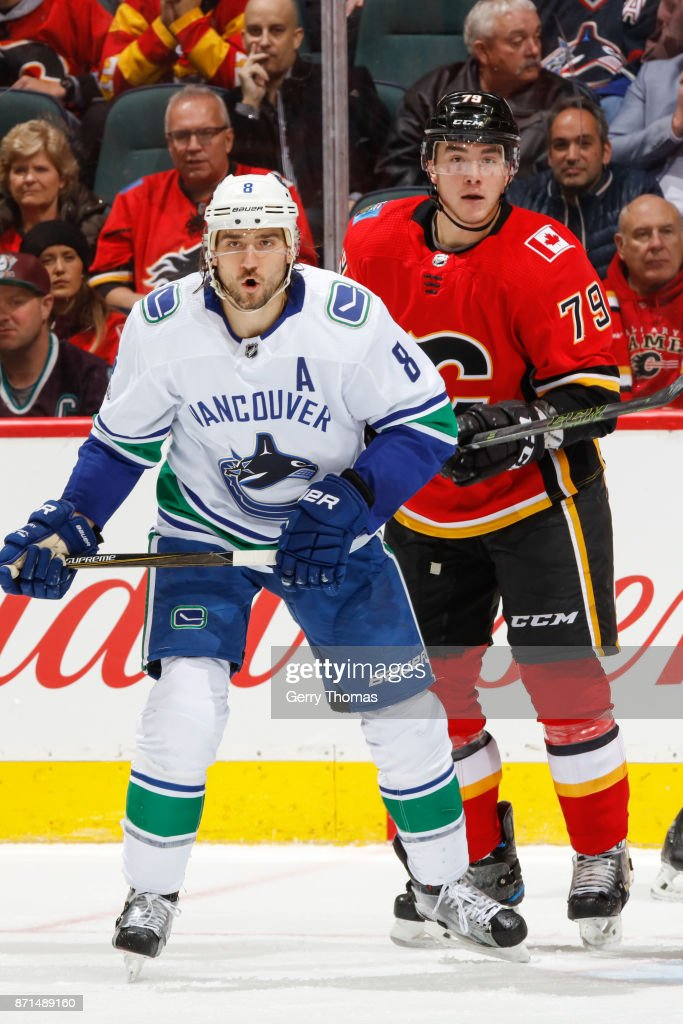 Christopher Tanev #8 of the Vancouver Canucks and Micheal Ferland #79 of the Calgary Flames in an NHL game against the Vancouver Canucks at the Scotiabank Saddledome on November 7, 2017 in Calgary, Alberta, Canada.