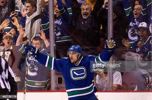 Christopher Tanev of the Vancouver Canucks celebrates after scoring the game winning goal against the Calgary Flames in overtime in NHL action in...