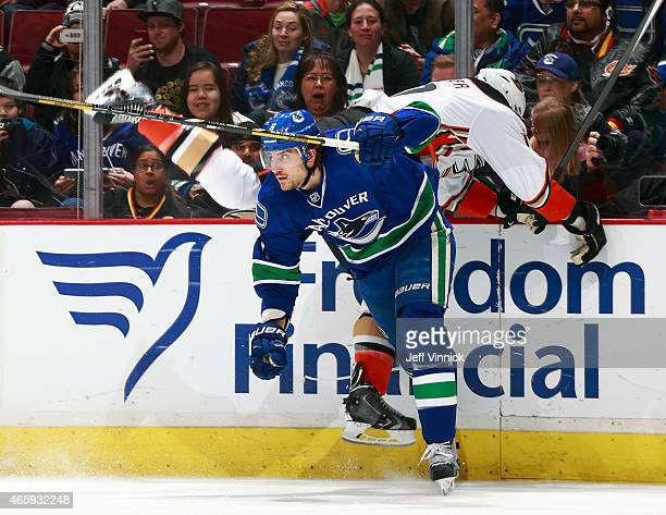 Christopher Tanev of the Vancouver Canucks checks Ryan Kesler of the Anaheim Ducks during their NHL game at Rogers Arena March 9, 2015 in Vancouver,...