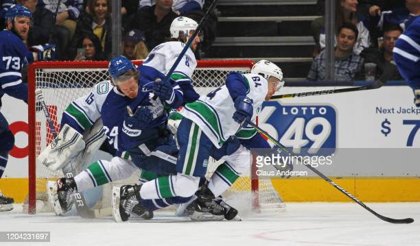 Christopher Tanev of the Vancouver Canucks draws a penalty for high sticking against Kasperi Kapanen of the Toronto Maple Leafs during an NHL game at...
