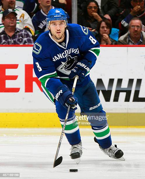 Christopher Tanev of the Vancouver Canucks skates up ice with the puck during their NHL game against the Edmonton Oilers at Rogers Arena October 11...
