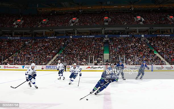 Christopher Tanev of the Vancouver Canucks skates with the puck as the Canucks and the Tampa Bay Lightning play threeonthree in overtime during their...