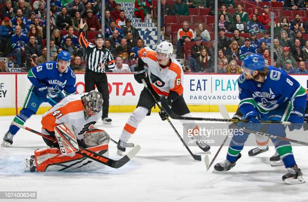 Christopher Tanev of the Vancouver Canucks takes a shot on Anthony Stolarz of the Philadelphia Flyers during their NHL game at Rogers Arena December...
