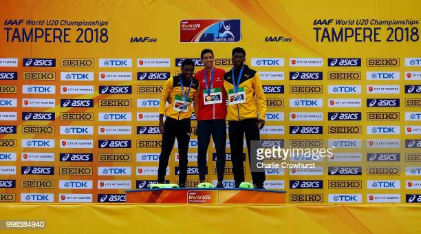 Christopher Taylor of Jamaica Jonathan Sacoor of Belgium and Chantz Sawyers of Jamaica celebrate after receiving their medals during the medal...