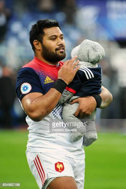 Christopher Tolofua and his baby at the end the RBS Six Nations match between France and Scotland at Stade de France on February 12 2017 in Paris...