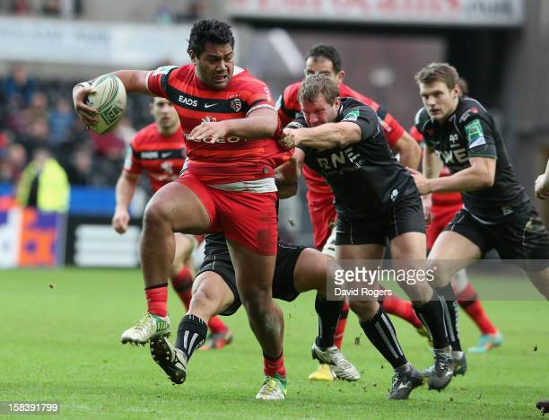 Christopher Tolofua of Toulouse charges upfield during the Heineken Cup match between Ospreys and Stade Toulouse at the Liberty Stadium on December...