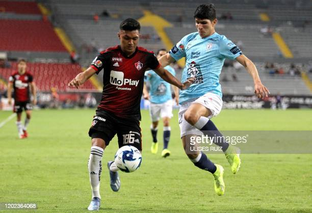 Christopher Trejo of Atlas vies for the ball with Miguel Tapias of Pachuca during the Mexican Clausura 2020 tournament football match at Jalisco...