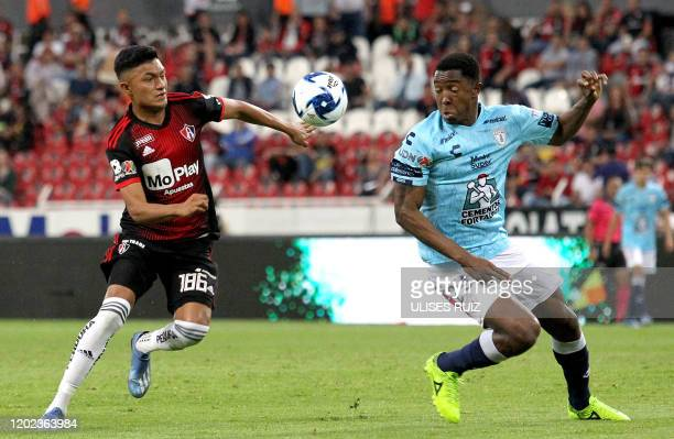 Christopher Trejo of Atlas vies for the ball with Oscar Murillo of Pachuca during the Mexican Clausura 2020 tournament football match at Jalisco...