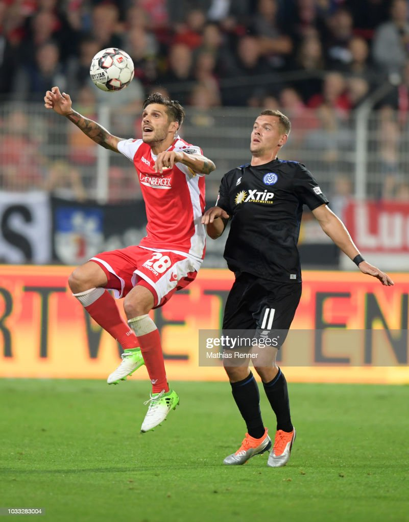 Christopher Trimmel of 1 FC. Union Berlin and Stanislav Iljutcenko of MSV Duisburg during the game between Union Berlin and the MSV Duisburg at the Stadion an der Alten Foersterei on september 14, 2018 in Berlin, Germany.