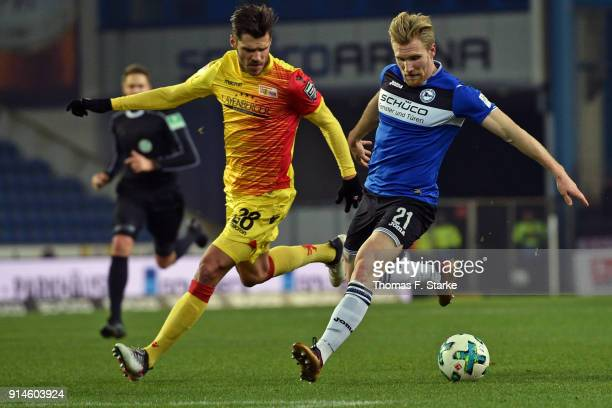 Christopher Trimmel of Berlin and Andreas Voglsammer of Bielefeld fight for the ball during the Second Bundesliga match between DSC Arminia Bielefeld...