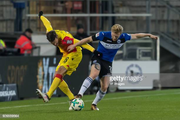 Christopher Trimmel of Berlin and Andreas Voglsammer of Bielefeld battle for the ball during the Second Bundesliga match between Arminia Bielefeld...