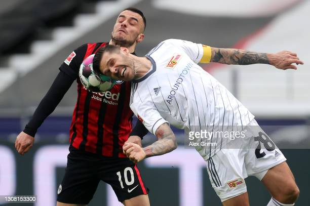 Christopher Trimmel of Union is challenged by Filip Kostic of Frankfurt during the Bundesliga match between Eintracht Frankfurt and 1. FC Union...