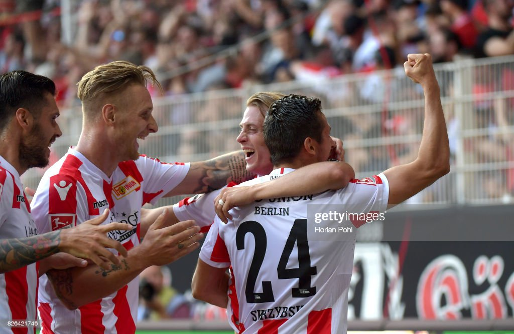 Christopher Trimmel, Sebastian Polter, Simon Hedlund and Steven Skrzybski of 1 FC Union Berlin celebrate after scoring the 3:2 during the game between Union Berlin and Kieler SV Holstein on august 4, 2017 in Berlin, Germany.