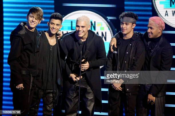 Christopher Velez, Erick Brian Colon, Zabdiel de Jesus, Joel Pimentel, and Richard Camacho of CNCO accept the Favorite Pop Artist award onstage...