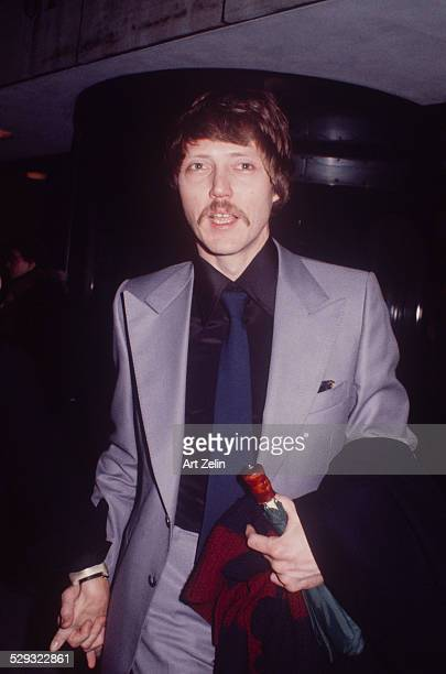 Christopher Walken in a gray suit and blue tie circa 1970 New York