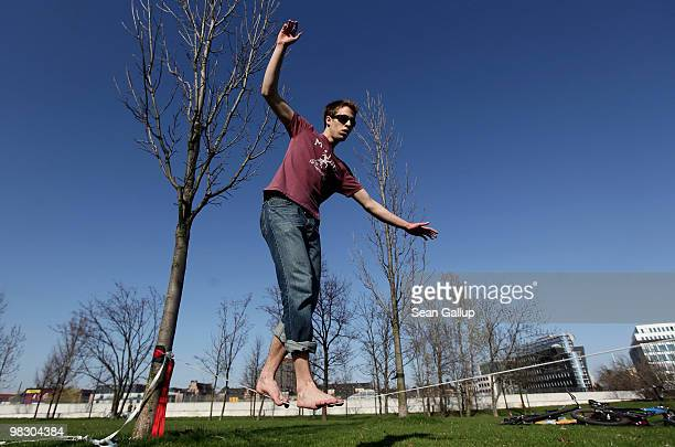 Christopher who preferred not to reveal his last name practices slacklining under blue skies on April 7 2010 in Berlin Germany Temperatures reached...