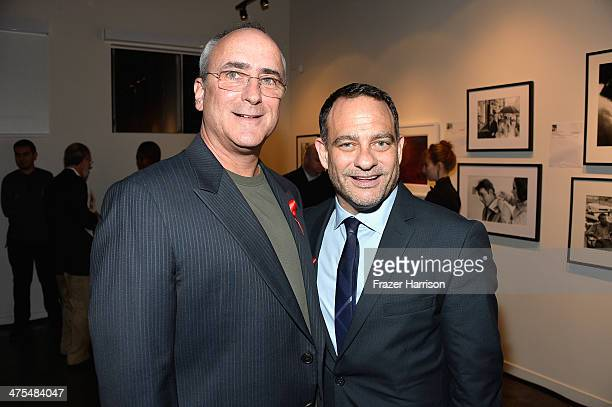 Christopher Wilding and Joel Goldman attend The Elizabeth Taylor AIDS Foundation Art Auction Benefit Presented By Wilding Cran Gallery on February 27...