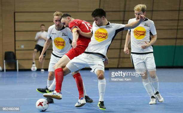 Christopher Wittig of Hohenstein Ernstthal battles for the ball with Jilo Hirosawa of Koeln during the German Futsal Championship final match between...