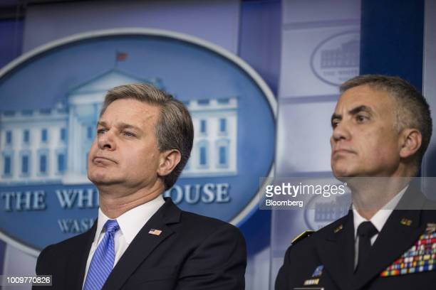 Christopher Wray director of the Federal Bureau of Investigation left and Paul Nakasone director of the National Security Agency and commander of the...