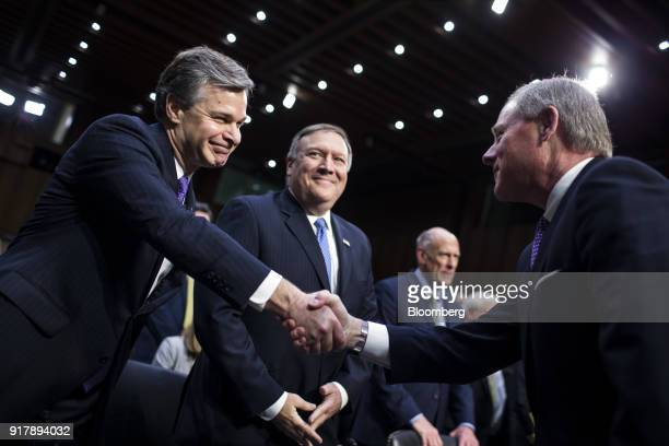 Christopher Wray director of the Federal Bureau of Investigation left shakes hands with chairman Senator Richard Burr a Republican from North...