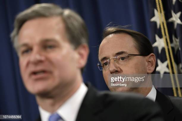 Christopher Wray director of the Federal Bureau of Investigation speaks while Rod Rosenstein deputy attorney general right stands during a news...