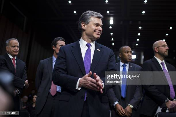 Christopher Wray director of the Federal Bureau of Investigation smiles before testifying during a Senate Intelligence Committee hearing on worldwide...