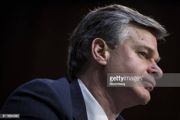 Christopher Wray director of the Federal Bureau of Investigation listens while testifying during a Senate Intelligence Committee hearing on worldwide...