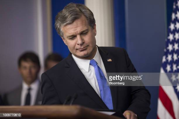 Christopher Wray director of the Federal Bureau of Investigation takes the podium to speak during a White House press briefing in Washington DC US on...