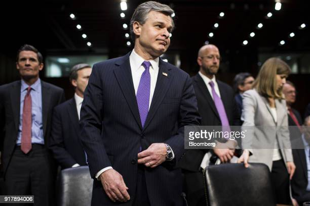 Christopher Wray director of the Federal Bureau of Investigation arrives to testify during a Senate Intelligence Committee hearing on worldwide...